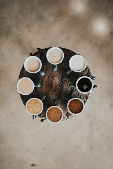 8 coffee mugs with different shades of coffee